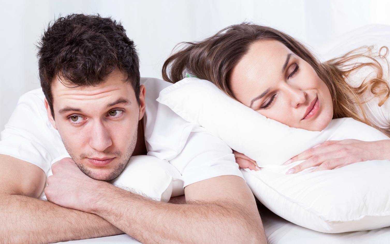 Woman sleeps while man is awake