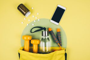 Workout essentials in a yellow bag